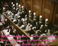 Defendants in the dock at nuremberg trials with text.png